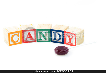 Baby blocks spelling candy stock photo, Baby blocks spelling candy. Isolated on a white background. by Richard Nelson