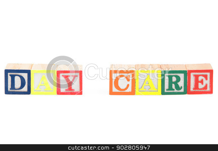 Baby blocks spelling day care stock photo, Baby blocks spelling day care. Isolated on a white background. by Richard Nelson