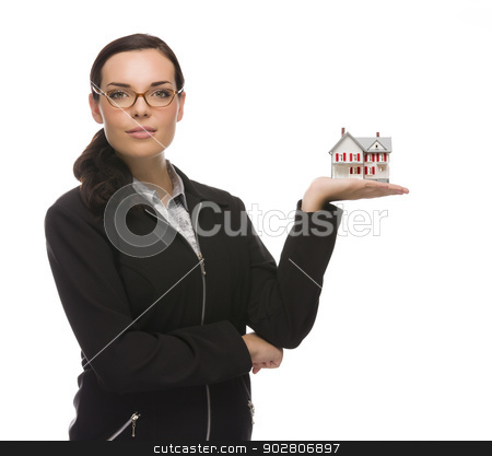 Mixed Race Businesswoman Holding Small House to the Side stock photo, Mixed Race Businesswoman Holding Small House to the Side Isolated on a White Background.  by Andy Dean