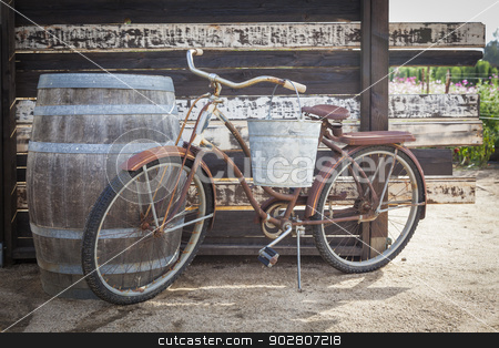 Old Rusty Antique Bicycle and Wine Barrel stock photo, Old Rusty Antique Bicycle and Wine Barrel in a Rustic Outdoor Setting.  by Andy Dean