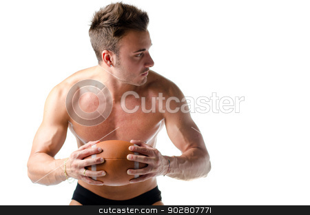 Handsome, serious young man shirtless, holding american football stock photo, Handsome, serious young man shirtless, holding american football ball in his hands by Stefano Cavoretto