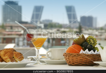 Breakfast in a terrace stock photo, Breakfast in a terrace of Madrid Hotel with buildings in the background by ABBPhoto
