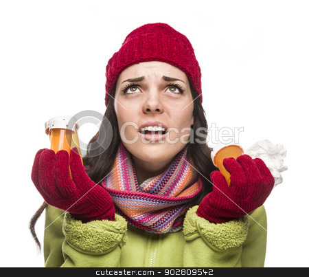 Sick Mixed Race Woman with Empty Medicine Bottles and Tissue  stock photo, Sick Mixed Race Woman Wearing Winter Hat and Gloves with a Tissue Holding Empty Medicine Bottle Isolated on White.  by Andy Dean