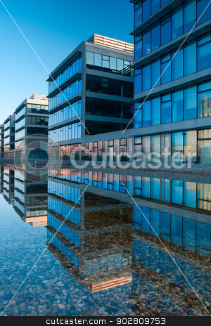 Office buildings stock photo, Office buildings near the lake by CaptureLight
