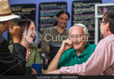 Group in Cafe Laughing stock photo, Mature people in a coffee house laughing by Scott Griessel