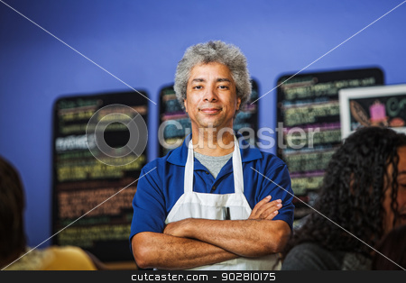 Confident Cafe Owner stock photo, Confident African coffee house owner with folded arms by Scott Griessel