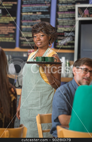 Gorgeous Barista Serving Coffee stock photo, Gorgeous barista in apron working in coffee house by Scott Griessel