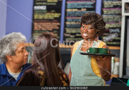 Cheeful Female Cafe Owner stock photo, Smiling barista apron working in coffee house by Scott Griessel