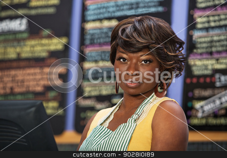 Grinning Barista in Cafe stock photo, Calm female cafe worker in coffee house by Scott Griessel