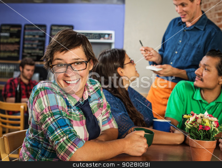 Cheerful Cafe Customer stock photo, Cheerful young white female with friends in coffee house by Scott Griessel
