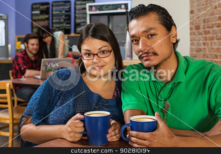 Handsome Latino Couple stock photo, Grinning Latino and Asian couple in cafe by Scott Griessel