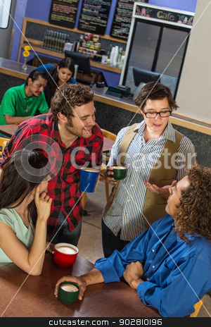 Mixed Group in Cafe stock photo, Mixed group of people in a coffee house by Scott Griessel