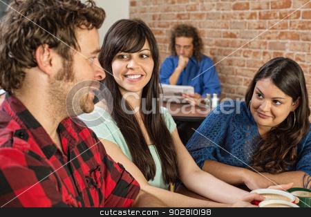 Friends Talking in Cafe stock photo, Three friends in a coffee house talking by Scott Griessel