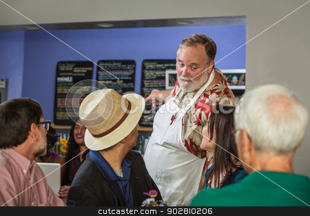 Chef Pointing to Menu stock photo, Handsome cafe barista showing customers menu by Scott Griessel