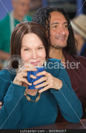 Smiling Woman in Cafe stock photo, Cheerful mature woman in cafe with handsome male friend by Scott Griessel