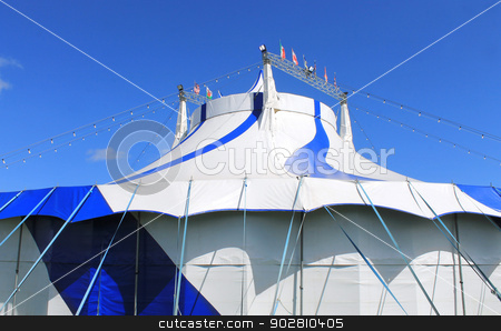 Blue and white big top circus tent stock photo, Blue and white big top circus tent with sky background. by Martin Crowdy