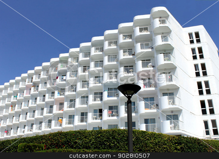 Holiday or vacation hotel stock photo, Holiday or vacation hotel with blue sky background. by Martin Crowdy