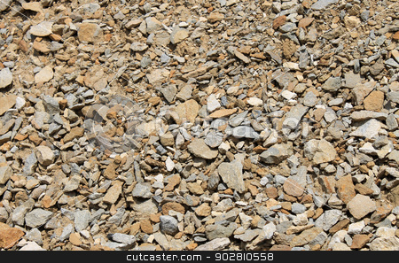 Piles of brown rocks stock photo, Abstract background of pile of brown rocks. by Martin Crowdy
