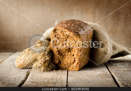 Bread assortment stock photo, Bread assortment on background of the old canvas by Givaga