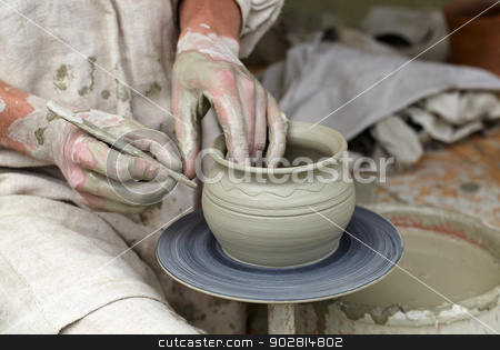 Potter's hands. stock photo, Potter's hands making a pot in a traditional style. by danr13
