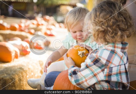 Young Family Enjoys a Day at the Pumpkin Patch stock photo, Adorable Young Family Enjoys a Day at the Pumpkin Patch. by Andy Dean