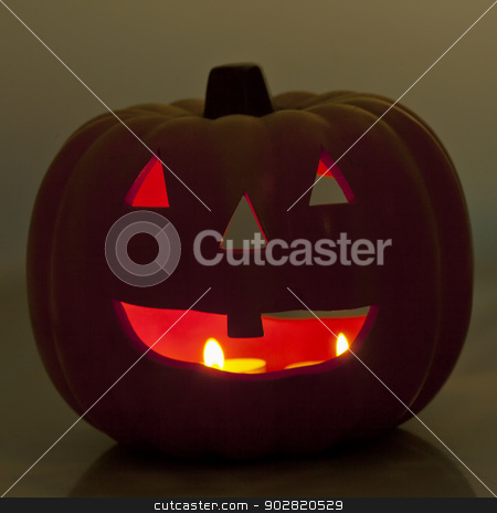 Jack-o-Lantern stock photo, Jack-O-Lantern with candles in the darkness by Fabio Alcini