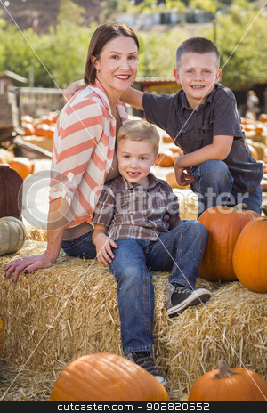 Portrait of Attractive Mother and Her Sons at Pumpkin Patch stock photo, Attractive Mother and Her Two Sons Pose for a Portrait in a Rustic Ranch Setting at the Pumpkin Patch.  by Andy Dean