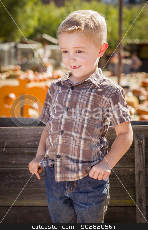 Little Boy With Hands in His Pockets at Pumpkin Patch stock photo, Adorable Little Boy at Pumpkin Patch With Hands in His Pockets Leaning on Antique Wood Wagon in Rustic Ranch Setting.  by Andy Dean