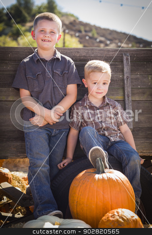 Two Boys at the Pumpkin Patch Against Antique Wood Wagon stock photo, Two Young Boys at the Pumpkin Patch Leaning Against Antique Wood Wagon. by Andy Dean