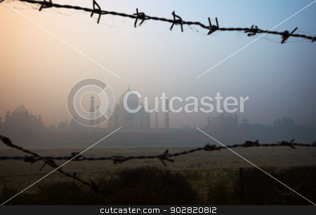 Taj Mahal from the riverside, trough barbed wire stock photo, View of the Taj Mahal from the riverside, trough barbed wire by Alexey Romanov