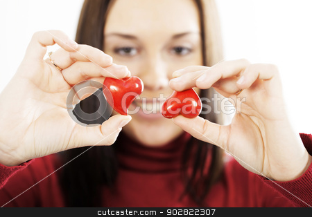 attractive smiling woman  with hearts stock photo, attractive smiling woman  with hearts over white by klenova