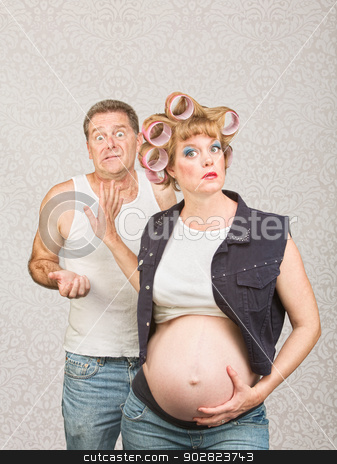 Frustrated Man with Pregnant Woman stock photo, Frustrated man with annoyed pregnant hillbilly woman by Scott Griessel