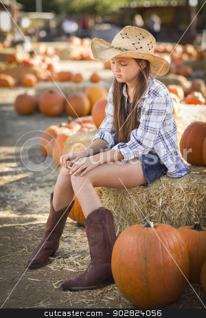 Preteen Girl Portrait at the Pumpkin Patch stock photo, Preteen Girl Wearing Cowboy Hat Portrait at the Pumpkin Patch in a Rustic Setting. by Andy Dean