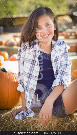 Preteen Girl Portrait at the Pumpkin Patch stock photo, Preteen Girl Portrait at the Pumpkin Patch in a Rustic Setting. by Andy Dean
