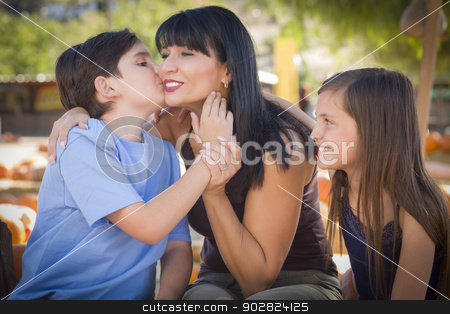 Attractive Mixed Race Family Portrait at the Pumpkin Patch stock photo, Attractive Family Portrait in a Rustic Ranch Setting at the Pumpkin Patch.  by Andy Dean