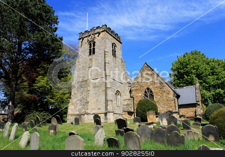 Old church and cemetery  stock photo, Scenic view of old village church with cemetery in foreground, England. by Martin Crowdy