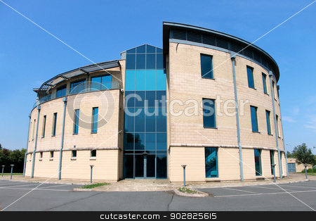 Vacant modern office building stock photo, Exterior of vacant modern office building available for lease on business park. by Martin Crowdy