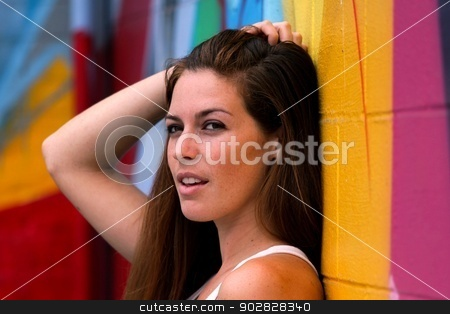 Portrait Of A Woman stock photo, Portrait Of A WomanSide view portrait of a woman with colorful wall in the background. by Henrik Lehnerer