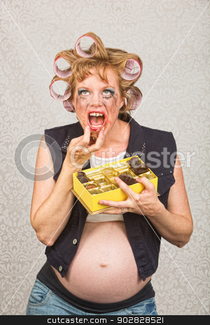 Hillbilly Pigging Out stock photo, Pregnant hillbilly pigging out on box of candy by Scott Griessel