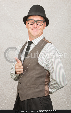 Man Gesturing Thumbs Up stock photo, Cute smiling man giving thumbs up gesture by Scott Griessel