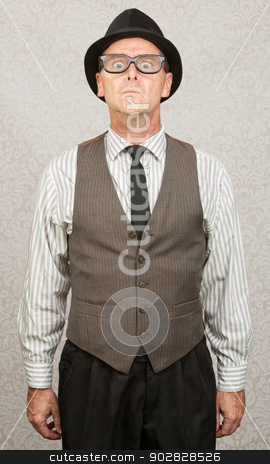Stiff Man Standing stock photo, Scared stiff businessman with hat and eyeglasses by Scott Griessel