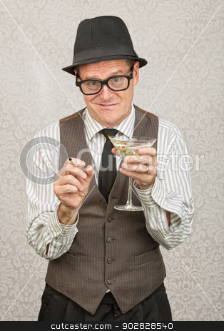 Smirking Drunk Man stock photo, Awkward tipsy business man with cigarette and martini by Scott Griessel