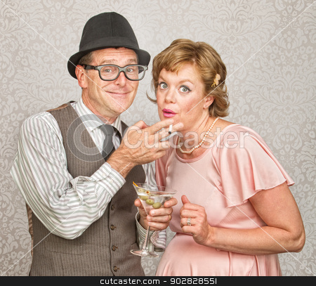 Pregnant Couple Smoking and Drinking stock photo, Expecting couple smoking cigarettes and drinking alcohol by Scott Griessel