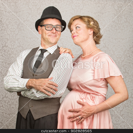 Hopeful Pregnant Couple stock photo, Man with folded arms and happy pregnant female by Scott Griessel