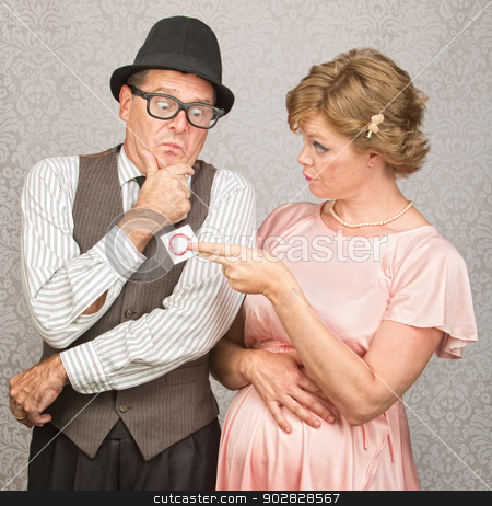 Nervous Man and Lady with Contraceptives stock photo, Worried man in hat with pregnant woman holding contraceptives by Scott Griessel