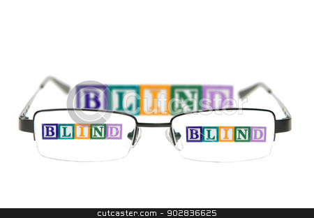 Letter blocks spelling blind through a pair of glasses stock photo, Letter blocks spelling blind through glasses. Isolated on white by Richard Nelson