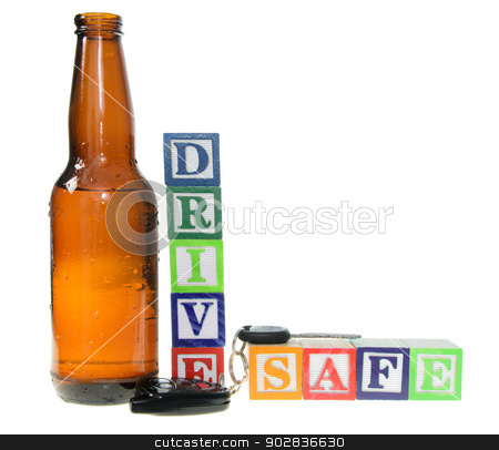Letter blocks spelling drive safe with a beer bottle and keys stock photo, Letter blocks spelling drive safe with a beer bottle and keys. Isolated on a white background by Richard Nelson