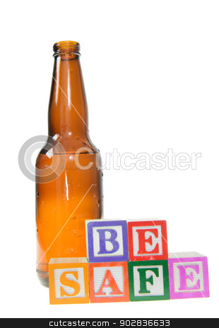 Letter blocks spelling be safe with a beer bottle stock photo, Letter blocks spelling be safe with a beer bottle. Isolated on a white background by Richard Nelson