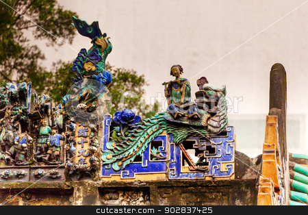 Porcelain Roof Chinese Figurines, Flutist,  Man Mo Temple  Hong  stock photo, Porcelain Chinese Roof Figurines Man Mo Temple Hollywood Road Hong Kong Island, China. Temple was built in 1847 and is one of the oldest temple on Hong Kong Island.  Man Tai is the literature god. by William Perry