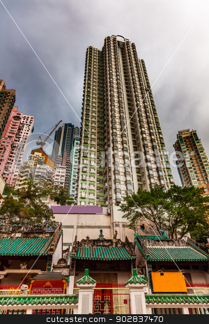 Man Mo Temple  Apartment Buildings Hong Kong China stock photo, Man Mo Temple Apartment Buildings Hollywood Road Hong Kong Island China. Temple was built in 1847 and is one of the oldest temple on Hong Kong Island.  Man Tai is the literature god. by William Perry